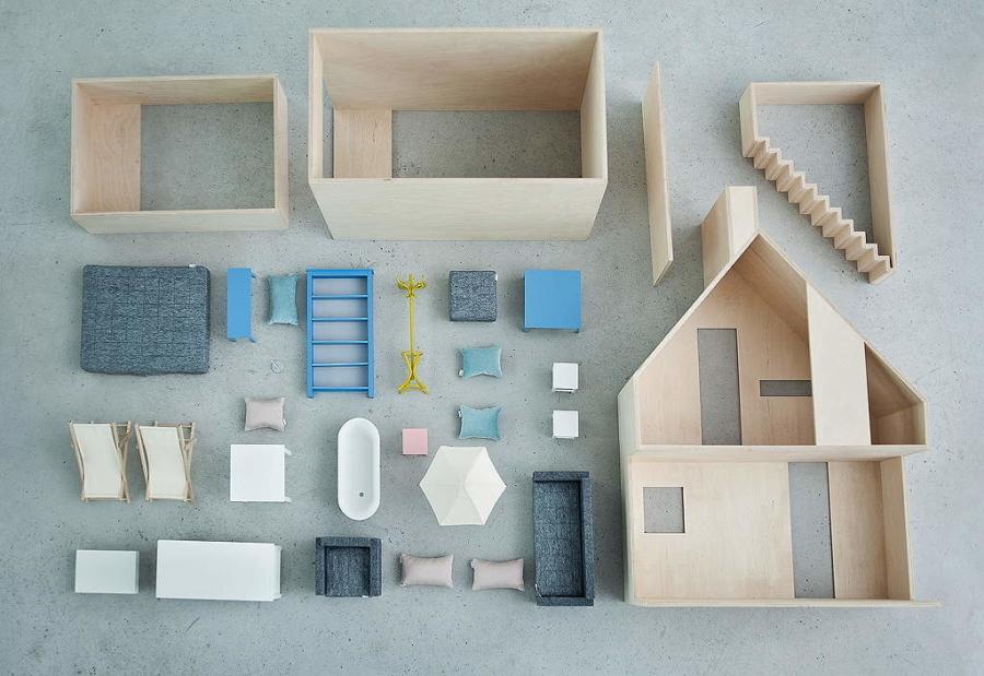 Das Boomini Dollhouse Wood in seinen Einzelteilen samt der modernen Einrichtung